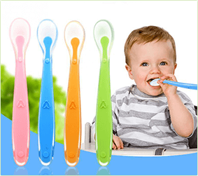 offer baby spoon